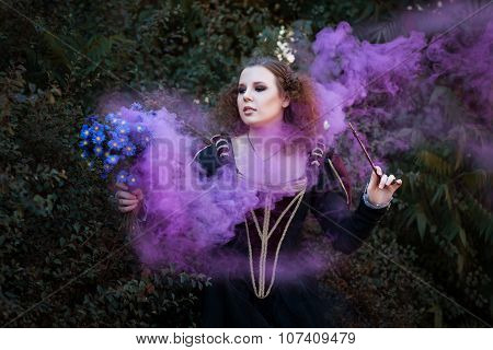 Woman Showing Tricks With A Magic Wand.