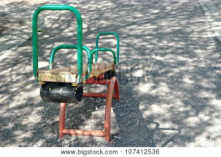 Seesaw teeter in park with a lot of copyspace