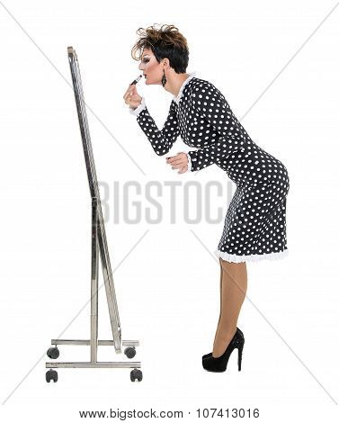 Drag Queen use Lipstick near Mirror on white background poster