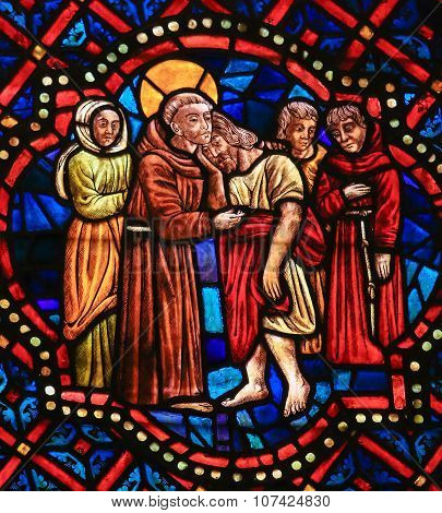 Stained Glass Of A Christian Saint Hugging Christ In Cathedral Of Leon, Spain