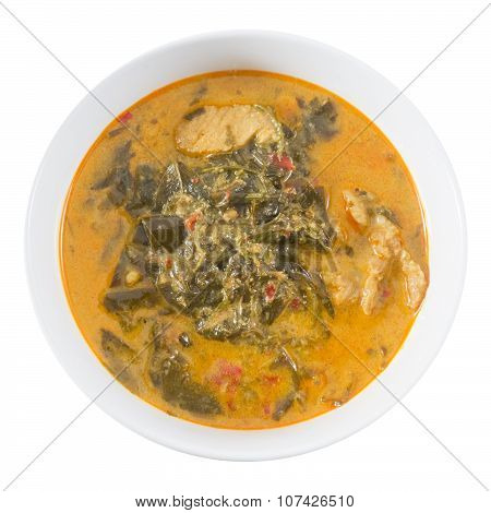 Thai Cuisine and Food Top View of Delicious Spicy Creamy Coconut Milk Curry with Cassia Leaves and Grilled Beef Fillet Isolated on White Background. poster