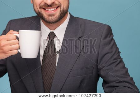 Cheerful mal reporter is enjoying hot tea