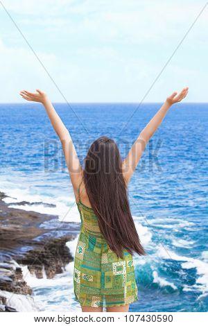 Biracial Teen Girl Arms Raised By Ocean Water In Praise
