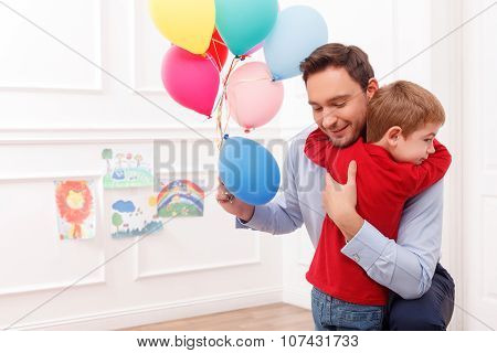 Cheerful family is celebrating the birthday of child