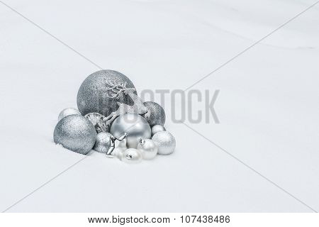 Metallic Grey Decorative Christmas Ornaments With Santa Claus's Reindeer At Natural Snow Backgro