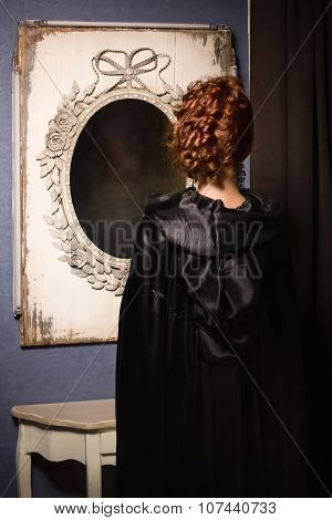 Pretty Woman Vamp Looking At Mirror