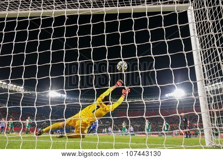 VIENNA, AUSTRIA - AUGUST 28, 2014: Jan Novota (#1 Rapid) fails to catch the ball in an UEFA Europa League qualifying game.