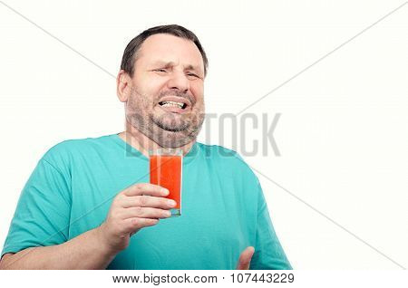 Fat man is filled with disgust by antioxidant drink