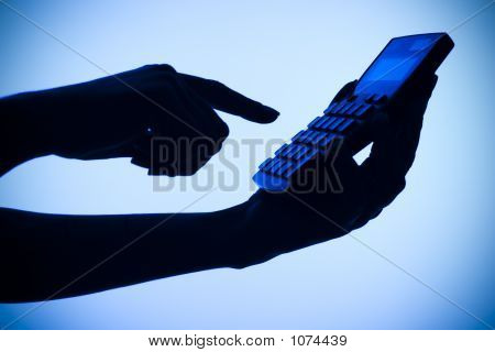 Silhouette Of Woman'S Hands With Calculator