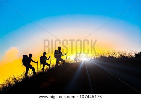 Three people family silhouettes on vacation