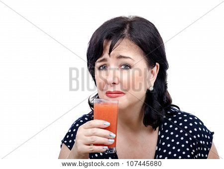 Crying woman is filled with disgust by antioxidant drink