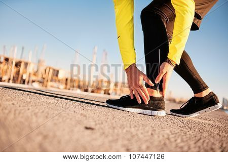 Broken twisted ankle - running sport injury. Athletic man runner touching foot in pain due to sprained ankle poster