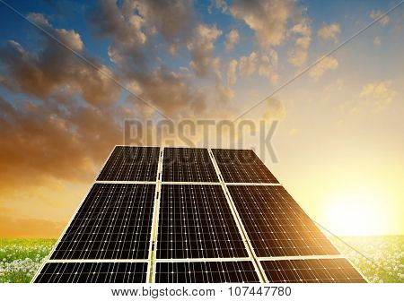 Solar energy panels against sunset sky.Clean energy.