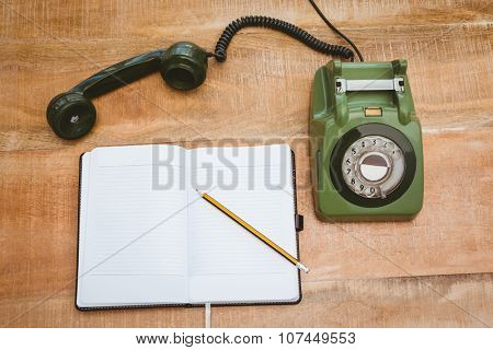 View of an old phone on wood desk
