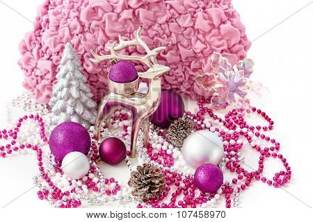 Christmas decoration with reindeer, pine tree, ornaments.