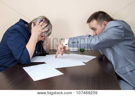 Two people sitting in office and thiking