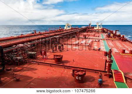 Red deck of a crude oil products tanker.