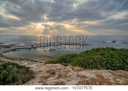 Sunbeams over sea and bay for fishing boats