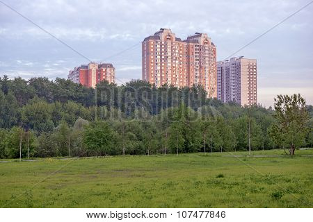 Summer landscape with modern residential buildings near park