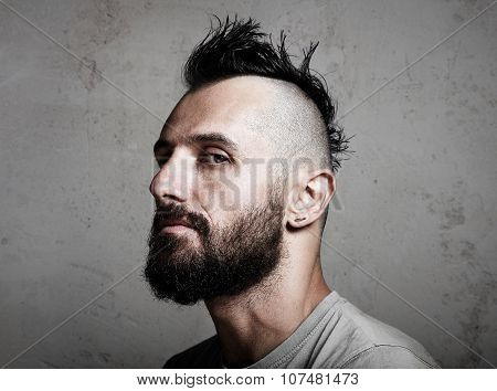 Close-up portrait of a brutal man with mohawk. Horizontal