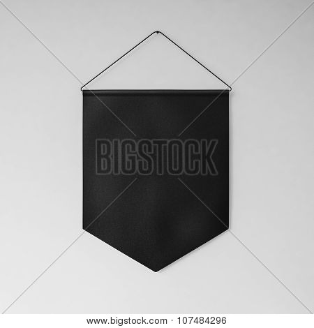 Black pennant hanging on the wall gray background. 3d render