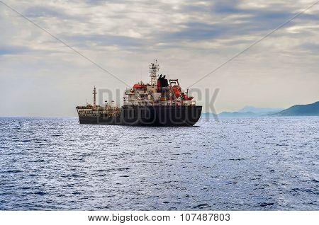 Side view of oil tanker ship exporting fuel and sailing in the sea