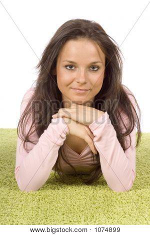 Young Woman Lying On The Green Carpet