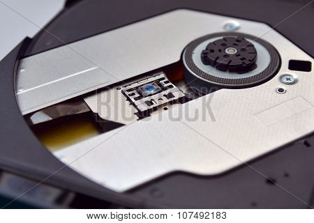 a Cd or dvd tray with lens poster
