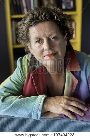 Portrait Smiling Woman In Her 60's.
