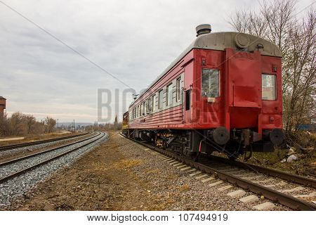 red-yellow locomotive train on the tracks