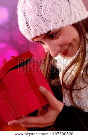 Girl Looking Into Gift