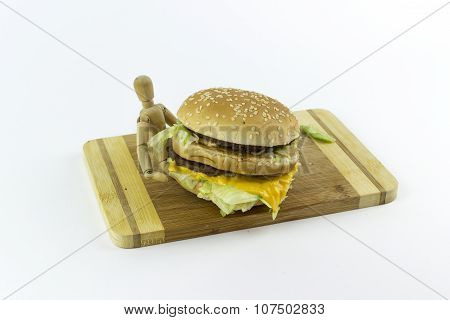 Wooden Doll Holding A Hamburger