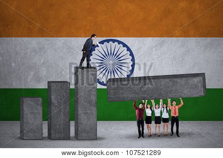 Workers Make Chart With Indian Flag Backdrop
