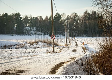 Road trough norwegian contryside in snowy winter afternoon poster