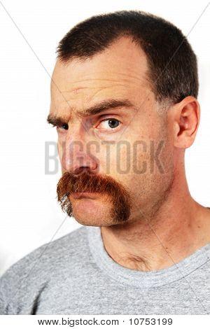 Man With Mustache Raising One Eyebrow
