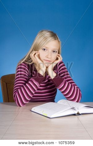 Young Blonde Woman With Open Book