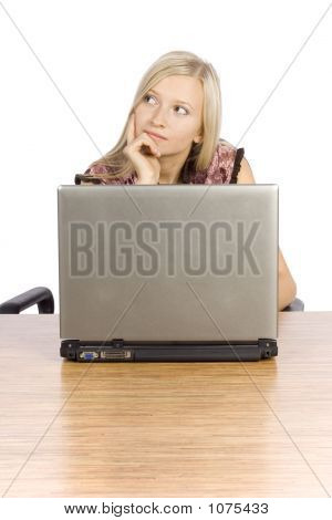 Young Blonde Woman At The Desk Working Laptop