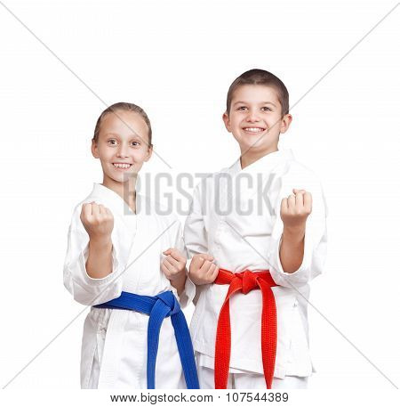 Two athletes in karategi are standing in the rack of karate