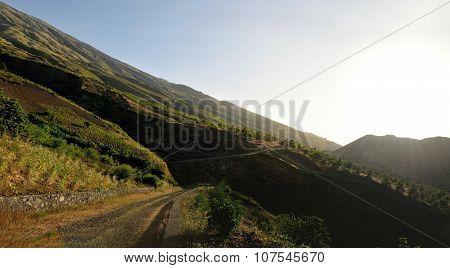 Says Rays Through Mountains