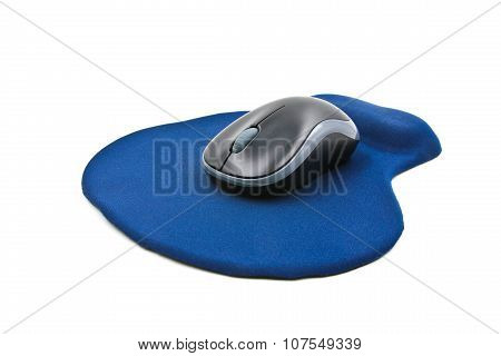 Wireless Computer Mouse On Blue Mouse Pad Isolated On White Background