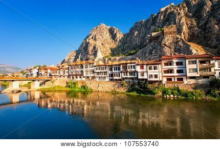 Traditional ottoman houses reflecting in the river Amasya Turkey poster