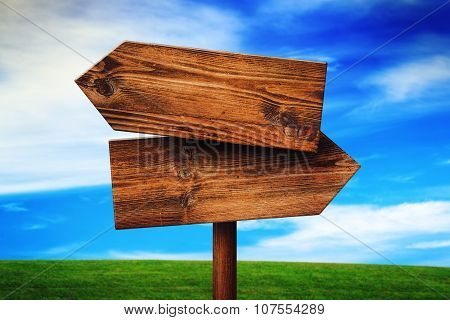 Blank Rustic Opposite Direction Wooden Sign On Grassland Field
