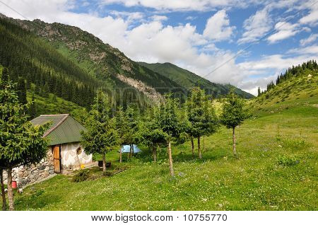 Colorful mountain hut with sky and clouds
