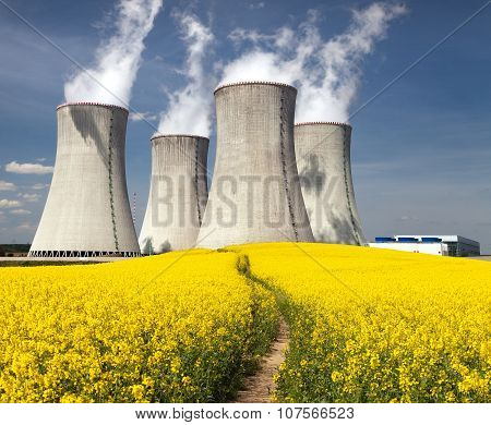 Nuclear Power Plant Dukovany With Golden Flowering Field
