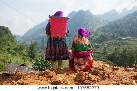 Vietnamese Hmong women standing on the side of a mountain pass