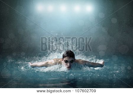 Swimmer in waterpool.