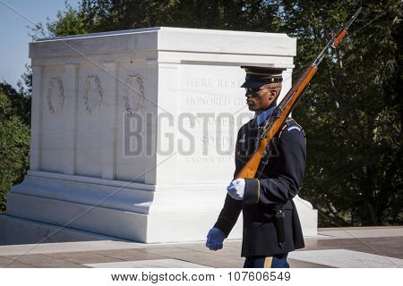 ARLINGTON, VA - SEPT 11, 2015: One of the sentinels from the 3rd U.S. Infantry Regiment maintaining a 24-hour, 365 days a year vigil at the Tomb of the Unknown Soldier in Arlington National Cemetery.