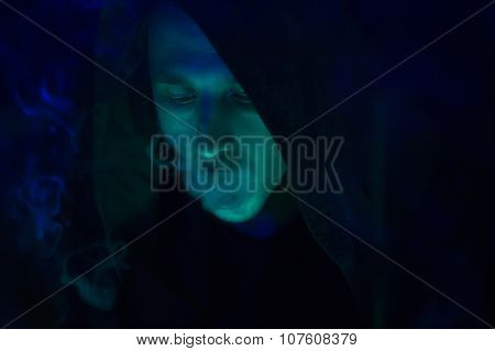 Club Party - Nightlife. Handsome Sexy Young Stylish Man In A Black Hood Smoking