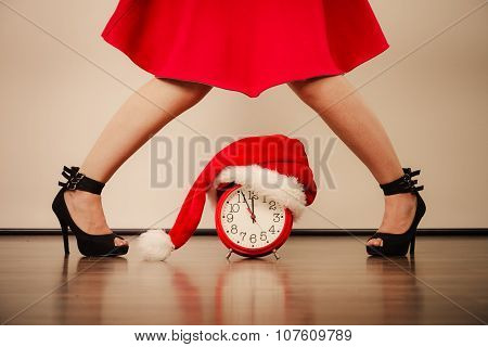 Woman In High Heels With Alarm Clock. Christmas.
