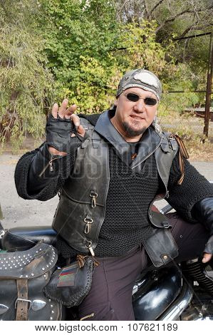 Biker In Black Clothes